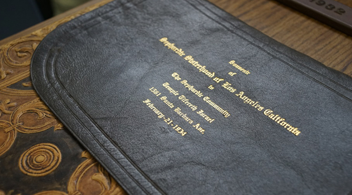 Leather pouch gold-stamped with 'Sephardic Sisterhood of Los Angeles California' and other details