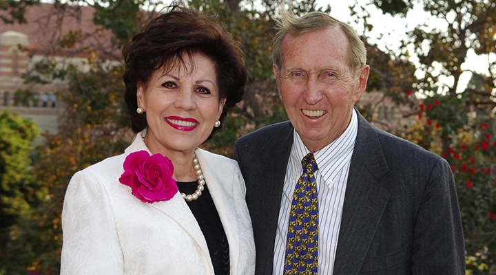 Marion and John Anderson pose for a picture on UCLA's campus