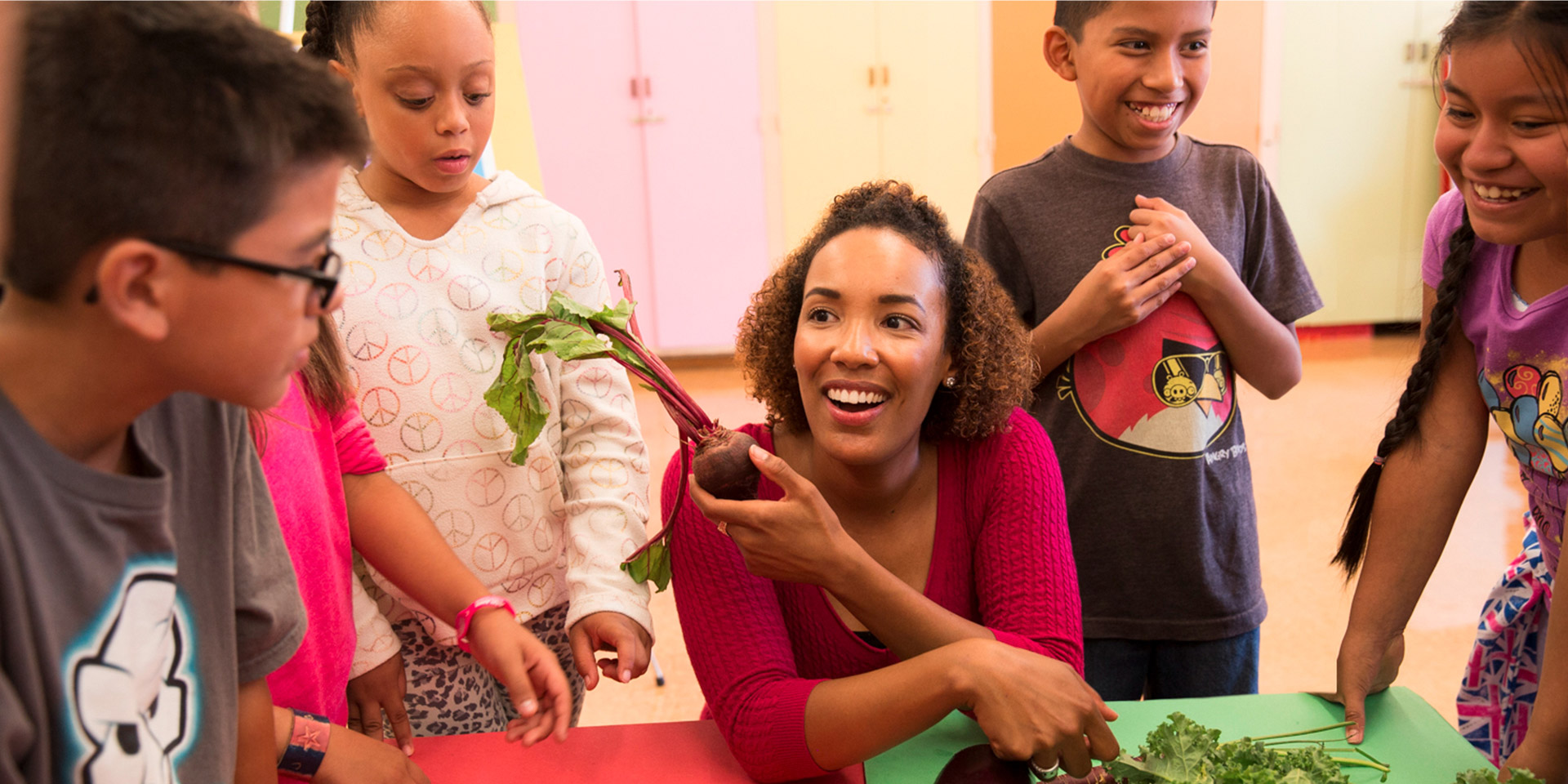 A K-12 teacher uses vegetables to engage students